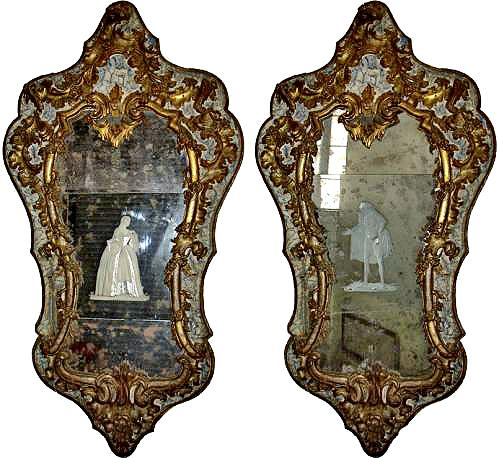 An Important Pair of Early 18th Century Giltwood and Parcel Gilt  Venetian Mirrors