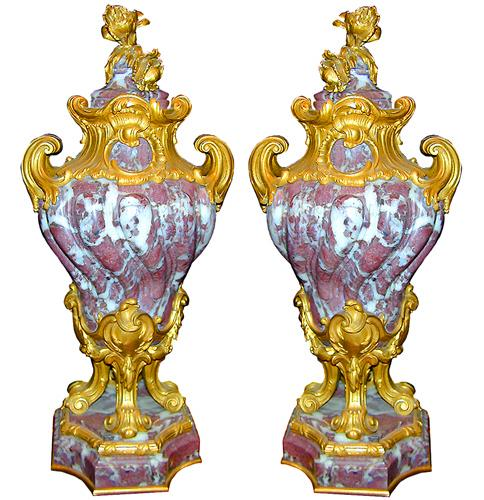 A	Pair of Italian Louis XIV Style Rouge and White Marble Urns