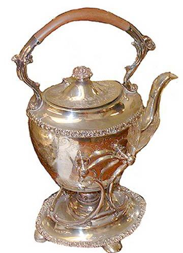 An Elegant 19th Century Silvered and Chased Tea Pot