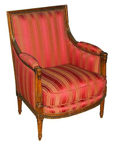 An 18th Century French Directoire Walnut Bergere